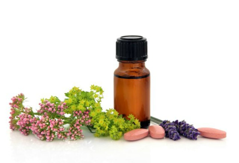 My First Experiences with Essential Oils - Lavender herb valerian ladies mantle flower heads and aromatherapy bottle with alternative medicin 1blog - My First Experiences with Essential Oils